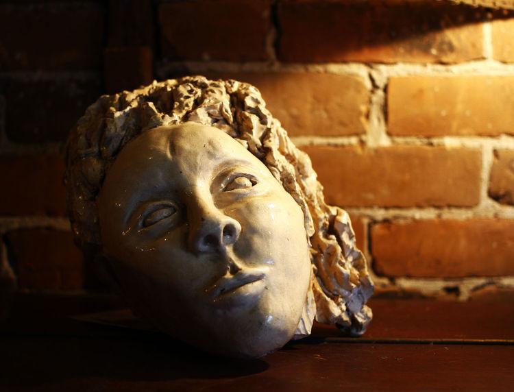 BEHEADED Head Sculpture Brick Wall Close-up Dim Lighting Indoors  Sculpture Statue Still Life