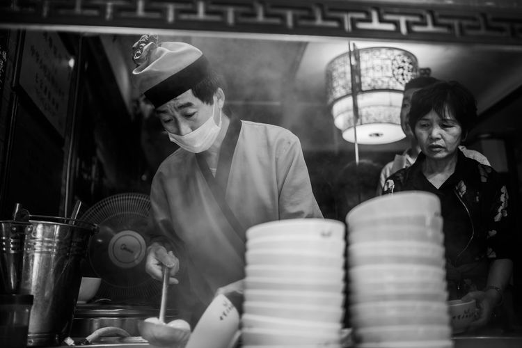 Black And White Street Photography Cooking Adult Black And White Black And White Photography Bowls Business Emotion Food And Drink Indoors  Lifestyles Mature Men Men People Real People Shanghai Street Photography Street Photography Streetphoto_bw Streetphotography Streetphotography_bw Two People Waist Up Women The Street Photographer - 2018 EyeEm Awards