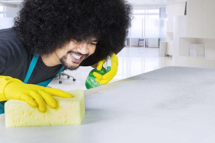 Man Cleaning Kitchen Island
