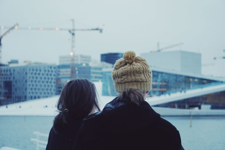 Rear view of women in city during winter