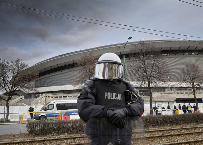 Police Spodek Katowice One Person Transportation Mode Of Transportation Real People Sky Cloud - Sky Nature Day Helmet Clothing Public Transportation Front View Rail Transportation Men Train Architecture Built Structure Occupation Standing Outdoors Warm Clothing