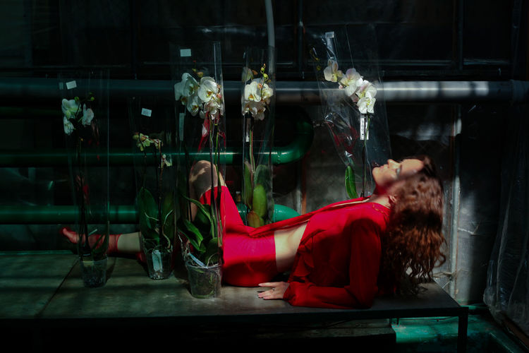 Digital composite image of woman relaxing in glass window
