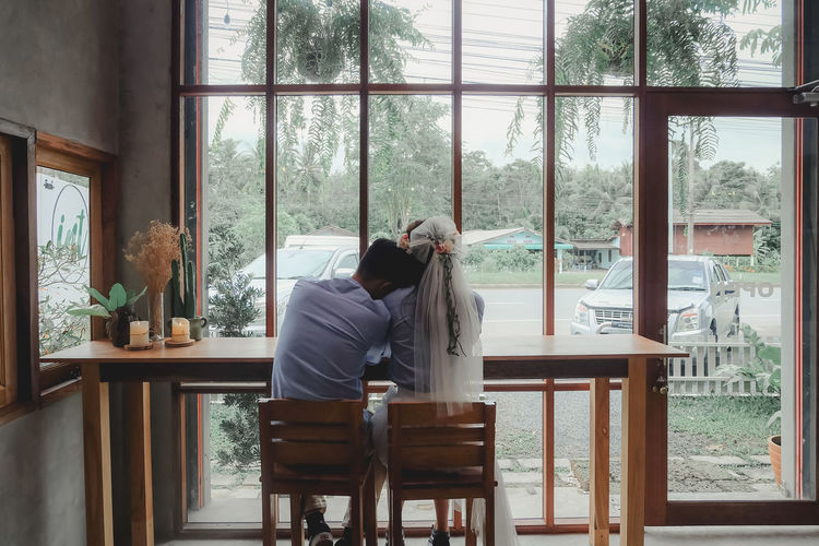 wedding Two People Women Chair Table Real People Indoors  Window Lifestyles Adult Men Leisure Activity People Togetherness Relaxation Couple - Relationship Positive Emotion Love Wedding Wedding Photography