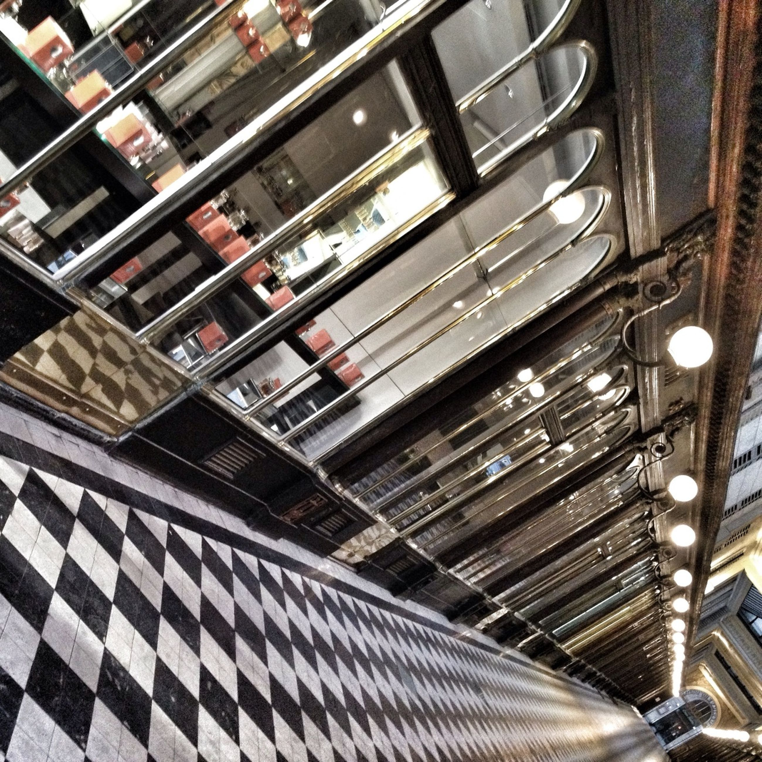 indoors, high angle view, in a row, steps, pattern, no people, steps and staircases, seat, technology, railing, metal, directly above, chair, repetition, arrangement, absence, staircase, large group of objects, order, modern