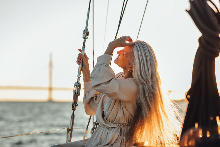 Smiling senior woman enjoying in boat