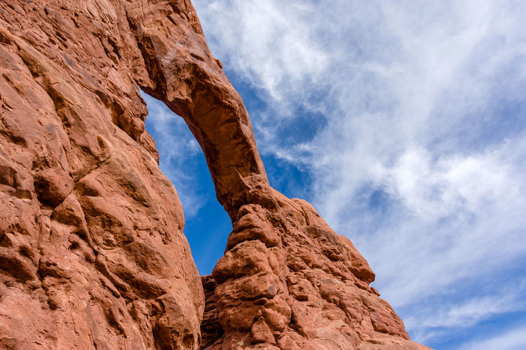 Arches National Park, Utah Beauty In Nature Cloud - Sky Day Landscape Low Angle View Natural Arch Nature No People Outdoors Rock - Object Rock Climbing Scenics Sky Travel Destinations