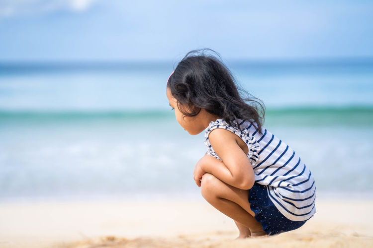 Side view of woman on beach