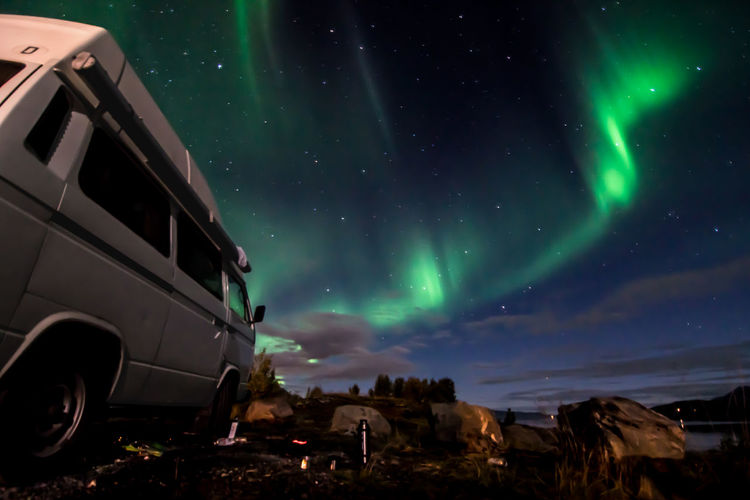 NL VWbus NorthernLights Night Star - Space Astronomy Sky Space Transportation Mode Of Transportation Beauty In Nature Travel Destinations Scenics - Nature Motor Vehicle Space And Astronomy Environment Dramatic Sky Science Illuminated Nature Travel Car Landscape