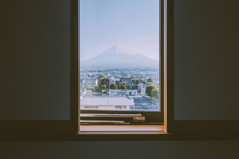 Cityscape seen through window