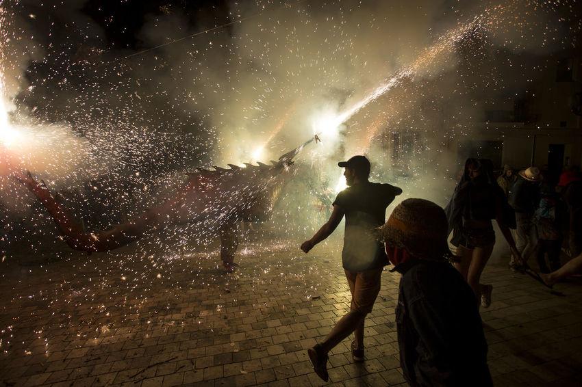 Besties a les festes de Sant Roc 2016 Besties Celebration Culture Dragon Fire Firerun Firework - Man Made Object Firework Display Fireworks First Eyeem Photo Light Light And Shadow Men Motion Night Outdoors Sant Roc Scene Tranquility