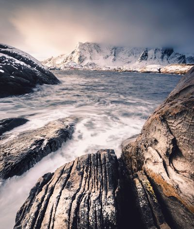 Cold Temperature Snow Beauty In Nature Nature Winter Scenics Mountain Rock - Object Ice Tranquil Scene Outdoors Glacier Sea No People Sky Water Day Wave Astronomy Lofoten Lofoten Islands Lofoten Norway Hamnøy Norway Norway Nature