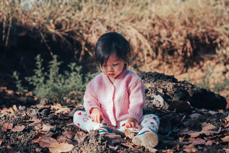 Girl sitting on field