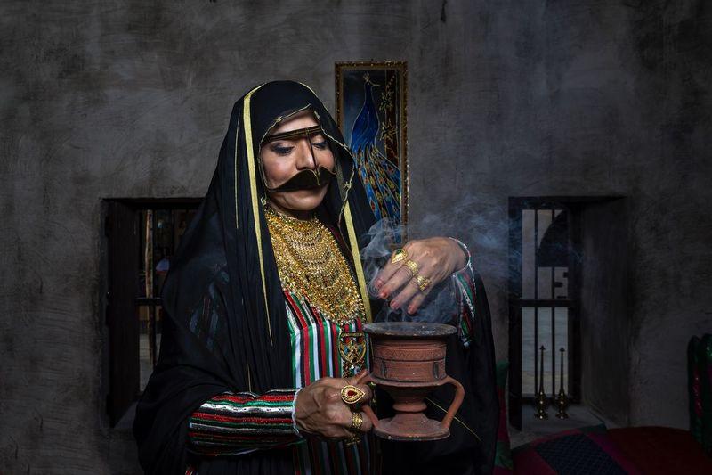 Woman wearing costume performing magic