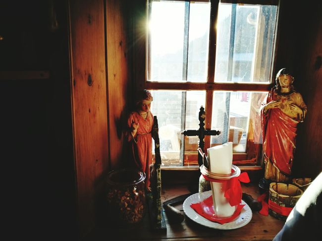 Window Indoors  Table Home Interior Day No People Altars Worship Places Devotion Devoted Devotion And Love Christian Catholic Catholic Faith Faith Intimate Intimacy Intimate Moments Light And Shadow Sunbeam Windows Window Frame Indoors  Looking To The Other Side Tranquil Scene This Is Aging