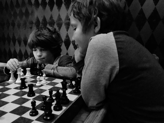 Two People Chess Strategy Leisure Activity Chess Board Chess Piece Concentration Boys Playing Leisure Games Competition Child Togetherness Males  Childhood Indoors  Challenge Lifestyles Brother Patterns Squares Diamond
