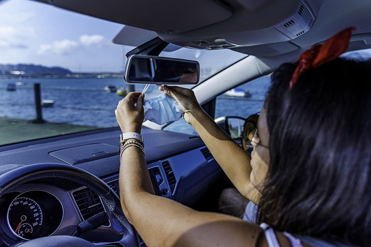Woman photographing car