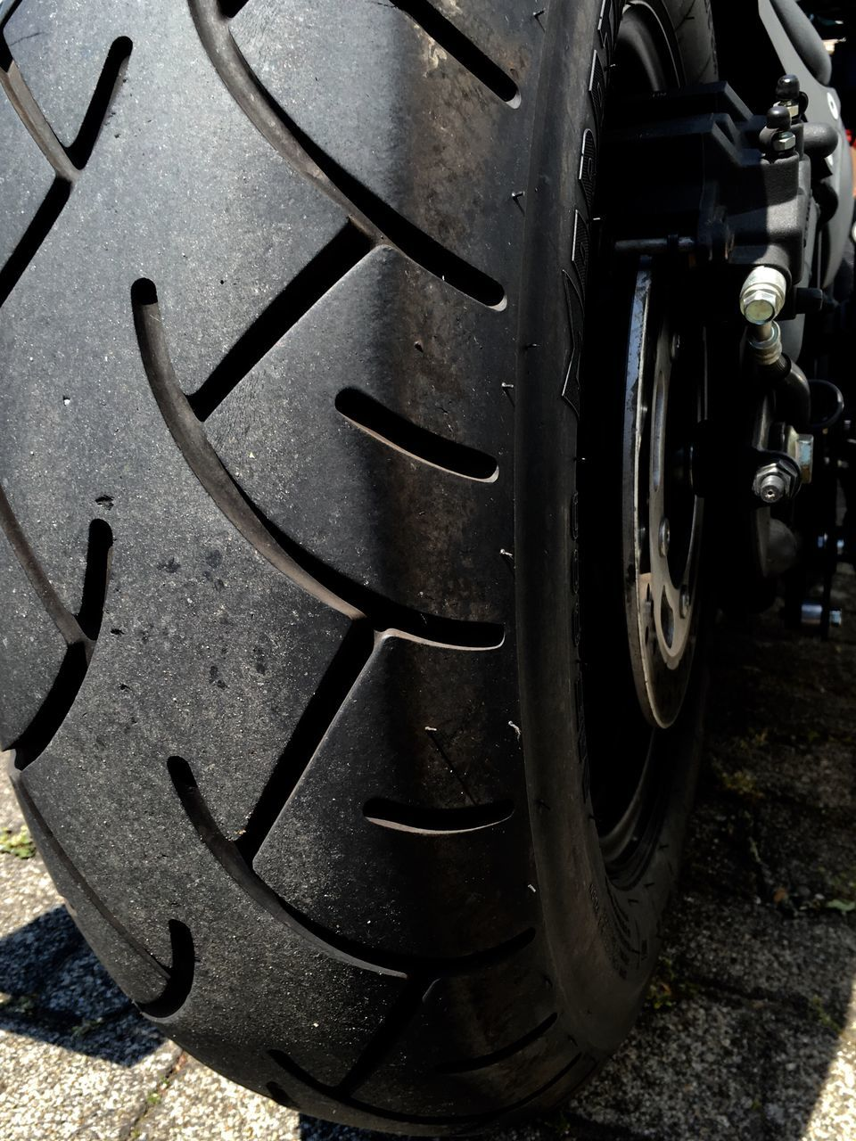 Close-Up Of Motorcycle Tire On Street