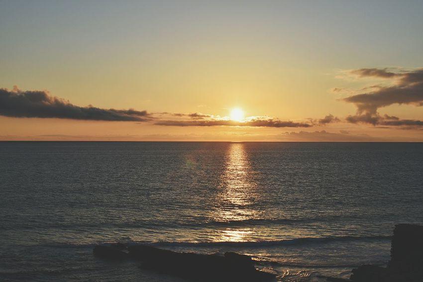 Sunset at seaside Afternoon Sunlight Reflecting On Water Water Wave Sea Nautical Vessel Sunset Beach Sailing Beauty Summer Seascape Coastal Feature Coastline Calm Coast Ocean