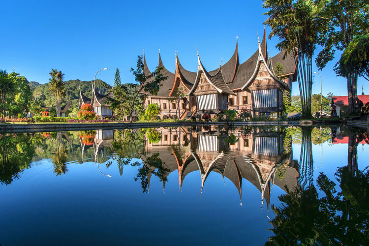 Reflection Of Rumah Gadang Minangkabau Best Shot 2018 EyeEm INDONESIA Memensaputra Air Refleksi Tradisional Rancakbana Sumatera Barat West Sumatera Gonjoang Rumah Gadang Water Tree City Blue Lake Clear Sky Reflection Sky Architecture Symmetry Reflecting Pool Waterfront Reflection Lake Palace Tourist Attraction  Standing Water