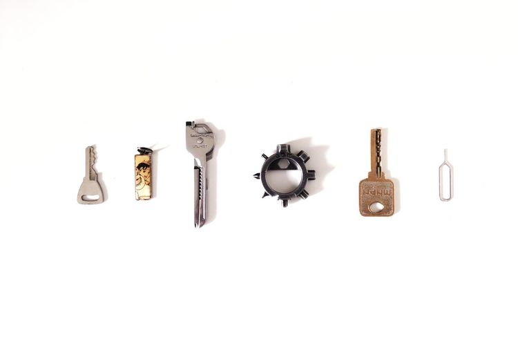 Directly above shot of various objects over white background
