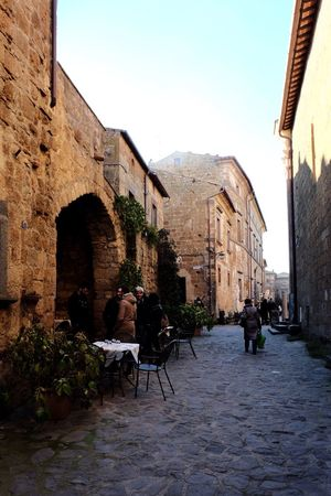 Architecture Building Exterior Built Structure Clear Sky Real People Sunlight Outdoors Men Sky Day Civita Di Bagnoregio Medieval Architecture Vicoli Tranquility People Adult