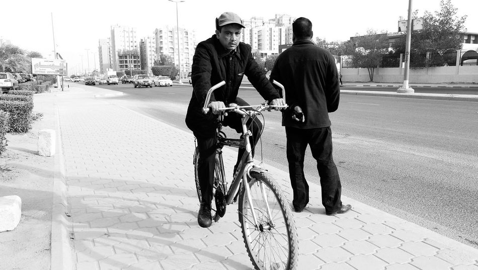Man standing Man With Bicycle Two People Togetherness Outdoors Full Length Transportation Mature Men Monochrome Photograhy Photography Themes Winter Morning Urban Photography Lifestyles Rear View Close-up Waiting For The Bus Street Photography daytime Man Holding A Mobile