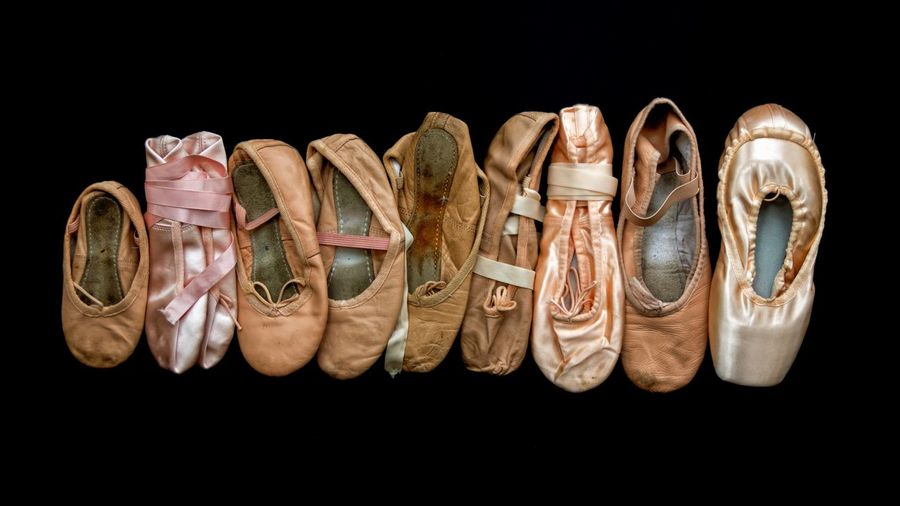 Ballet shoes Pink Color Growing Growth Ballet Shoes EyeEm Selects Black Background Studio Shot Shoe No People Still Life Cut Out Pair Indoors  Close-up Group Of Objects Variation Sandal Nature Seashell Directly Above Side By Side Silver Colored