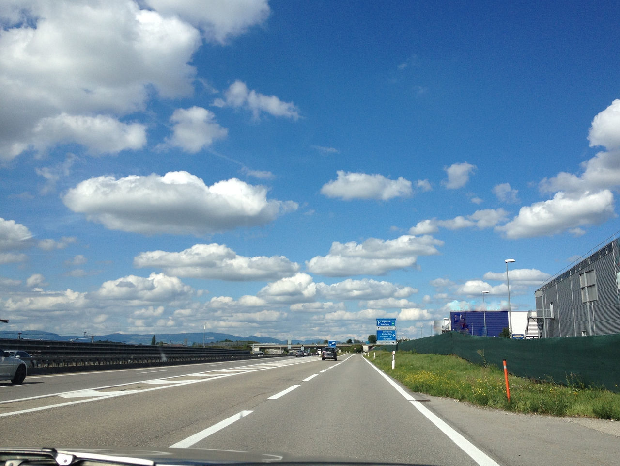 road, cloud - sky, road marking, sky, transportation, the way forward, day, dividing line, outdoors, no people, architecture, built structure, nature