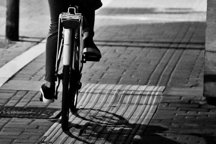 Architecture Bicycle City Cycling Focus On Foreground Footpath Land Vehicle Lifestyles Mode Of Transportation One Person Outdoors Paving Stone Real People Ride Riding Road Shadow Sidewalk Street Transportation Walking