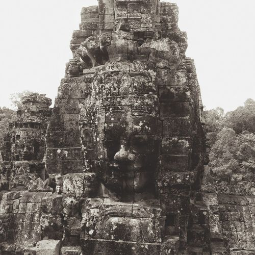 A smile behind the façade Angkor Siem Reap Angkor Thom Cambodia Temple Ancient Temple Travel Travel Photography Architecture Ancient Architecture Ancient Civilization Welcome To Black