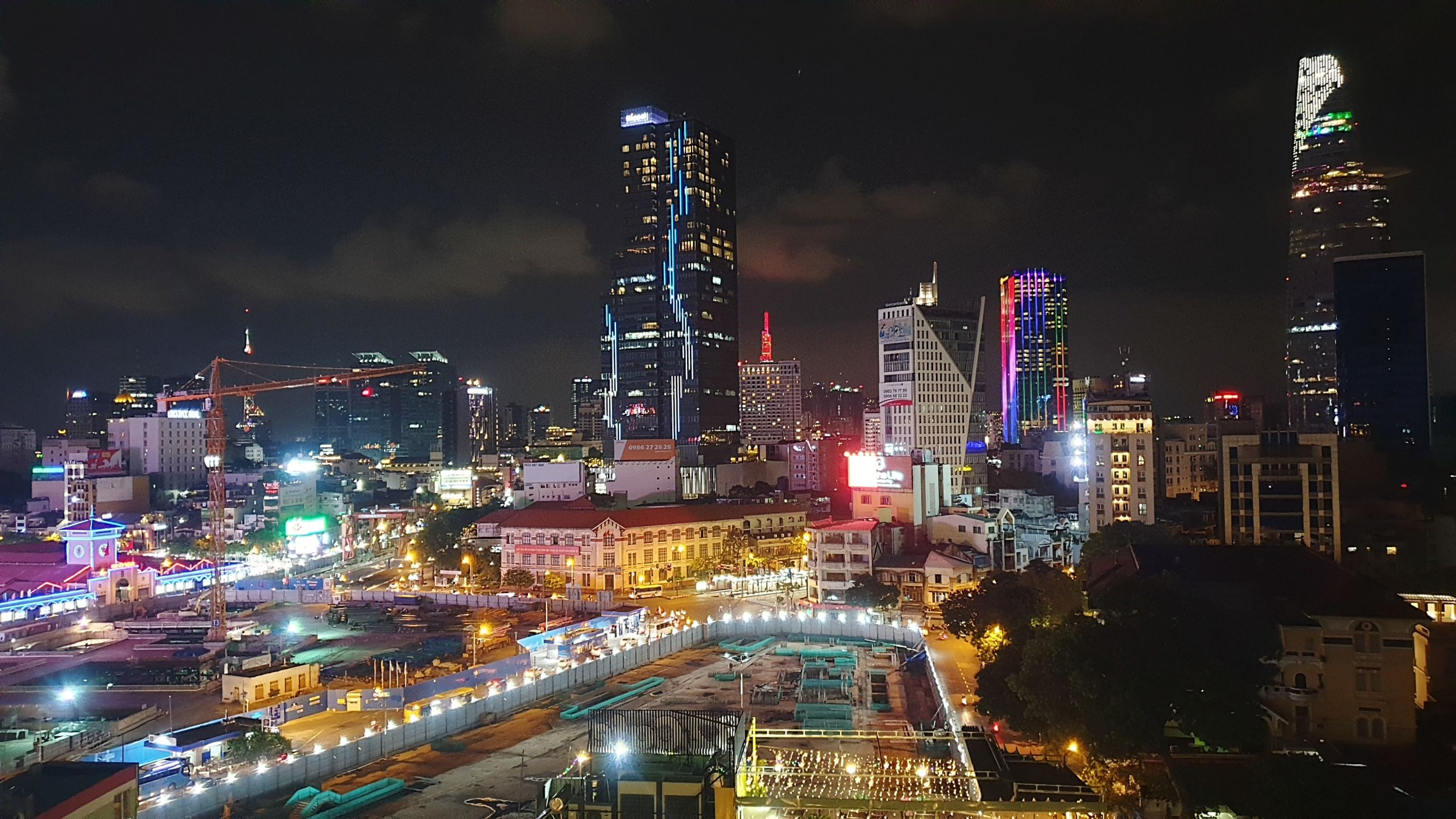 building exterior, illuminated, architecture, built structure, city, night, sky, building, tall - high, office building exterior, modern, skyscraper, cloud - sky, cityscape, tower, nature, no people, office, residential district, outdoors, financial district