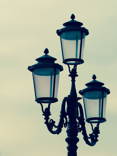 Low Angle View Of Gas Lights Against Sky