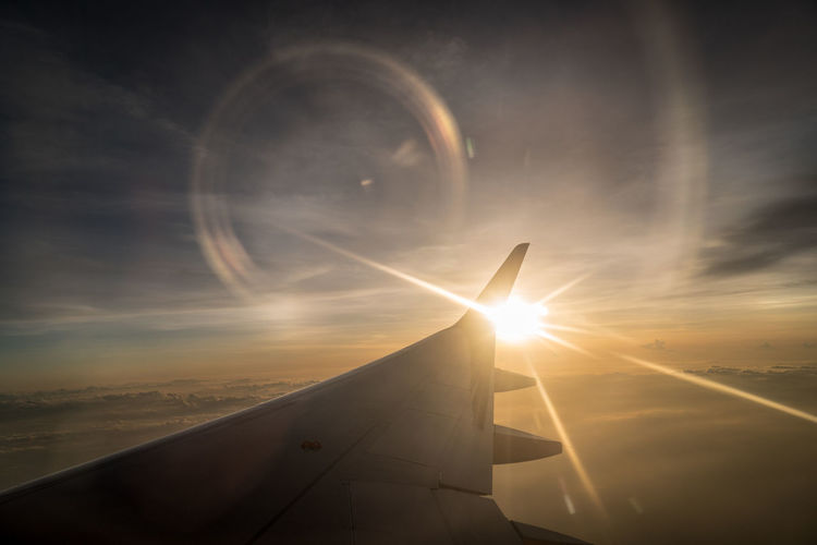 Air Vehicle Aircraft Wing Airplane Beauty In Nature Cloud - Sky Flying Lens Flare Mid-air Mode Of Transportation Nature No People Outdoors Scenics - Nature Sky Sun Sunbeam Sunlight Sunset Transportation Travel