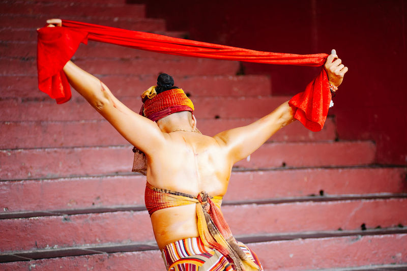 Rear View Of Dancer Performing On Street