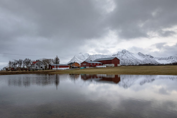 Norway Northern Norway Lofoten Lofoten Islands Puddle Mountain Water Scenics - Nature Sky Cloud - Sky Beauty In Nature Mountain Range No People Nature Reflection Cold Temperature Snowcapped Mountain Winter Snow Architecture Building Exterior Lake Building Waterfront Built Structure House