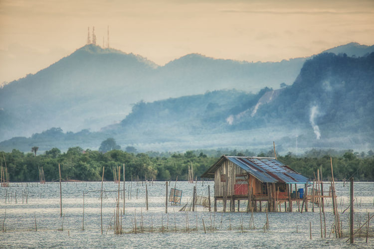 Architecture Built Structure Mountain Fog Sky Nature Building Exterior Scenics - Nature Landscape Building Fence No People Land Environment Tranquility Tree Tranquil Scene Boundary Beauty In Nature Outdoors Lake Songkhla Lake