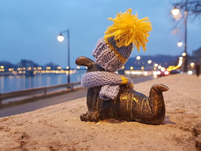 """""""Guerrilla"""" knitters put a scarf and a cap on this little sculpture in Budapest. The sculpture depicts a Hungarian cartoon character. Scarf Cap Knitter Guerrilla Knitting MyCity❤️ Budapest Hungary Streetphotography Cartoon Showcase February Dawn The Traveler - 2018 EyeEm Awards The Creative - 2018 EyeEm Awards The Fashion Photographer - 2018 EyeEm Awards"""