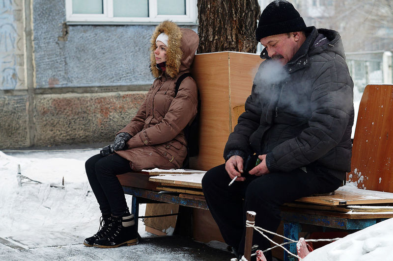 People sitting in park during winter