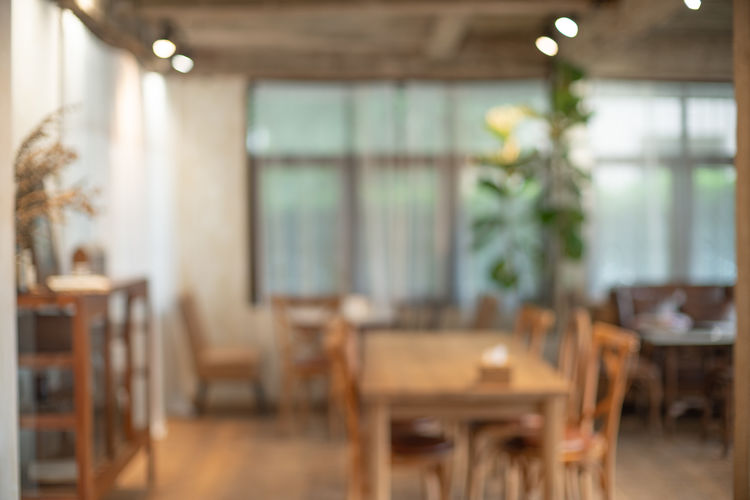Absence Blurred Background Business Cafe Chair Copy Space Day Defocused Domestic Room Electric Lamp Empty Focus On Foreground Food And Drink Furniture Indoors  Living Room Nature No People Restaurant Seat Table Window Wood - Material