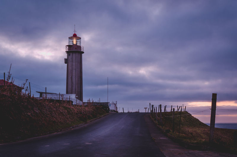 Lighthouse Acores Architecture Açores Açores - Portugal Built Structure Calm Cloud Cloud - Sky Cloudy Day Diminishing Perspective Direction Guidance Lighthouse Long Narrow Outdoors Protection Remote Safety Sky Solitude Tall Tall - High Tower Tranquility