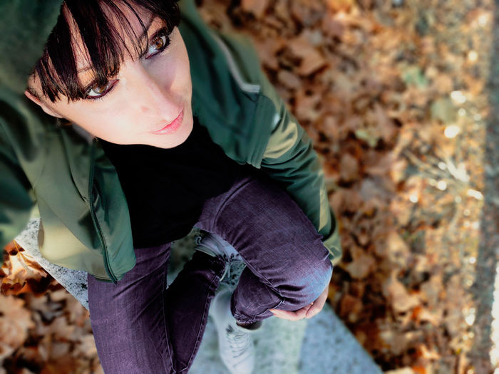 High angle view of girl looking away outdoors