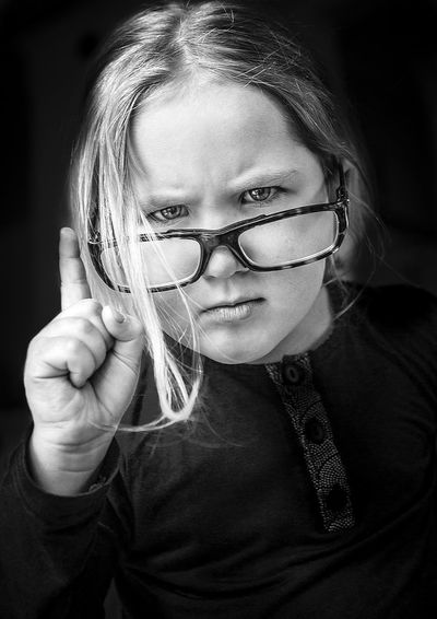 Portrait One Person Eyeglasses  Front View Glasses Looking At Camera Headshot Females Holding Child Women Smiling Real People Childhood Indoors  Emotion Black Background Glass Innocence Hairstyle
