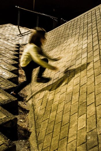 Blurred motion of man walking outdoors