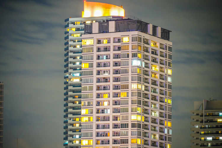 Low angle view of illuminated building against sky at dusk
