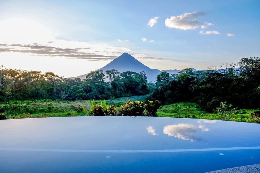 Arenal  Arenal Volcano National Park Costa Rica Costa Rica 🇨🇷 Costa Rica❤ Reflection Arenal Volcano Beauty In Nature Blue Cone Cone Shape Cone Shaped Day Idyllic Landscape Mountain Nature No People Outdoors Scenics Sky Tranquil Scene Tranquility Tree Water