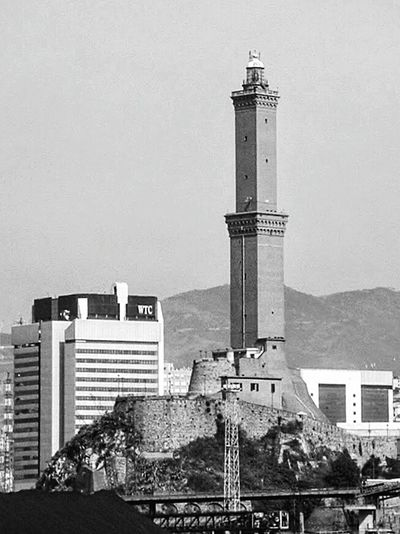 """La Lanterna - iconic Genoa's lighthouse"". Anno 1543 current tower. Phare Lighthouse Port Harbour View Boat Ride Sea Side Lanterna Black And White B&w Photography Iconic Buildings"