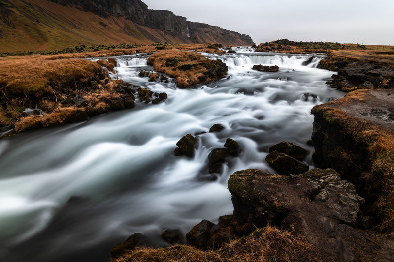 Small waterfall in iceland on a cloudy day in autumn