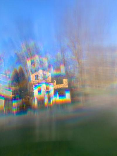 Defocused image of light trails against sky