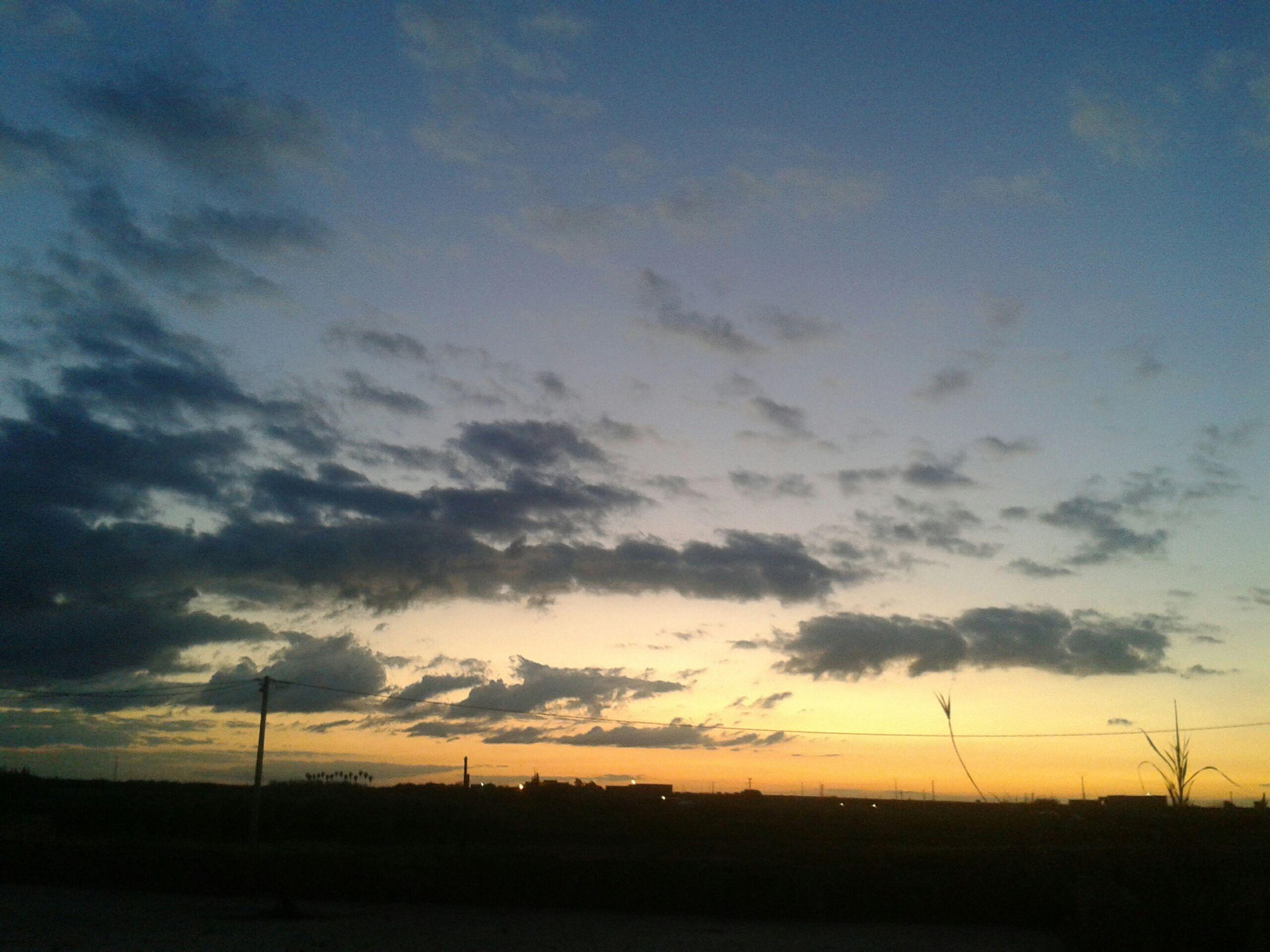 sunset, silhouette, sky, tranquil scene, tranquility, landscape, scenics, beauty in nature, cloud - sky, nature, field, electricity pylon, orange color, dusk, idyllic, dramatic sky, cloud, dark, outdoors, cloudy