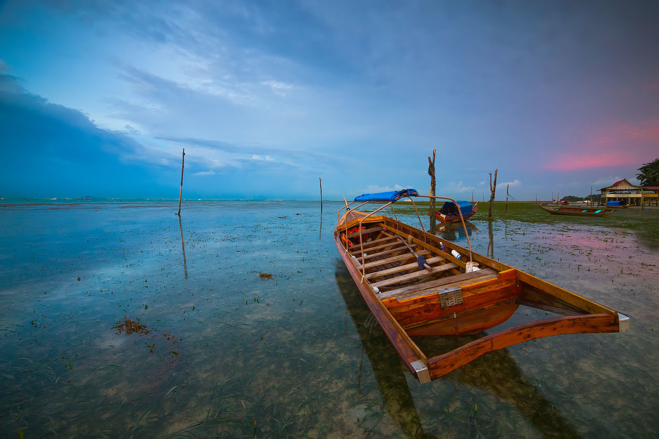 water, nautical vessel, sky, cloud - sky, transportation, mode of transportation, moored, sea, scenics - nature, tranquil scene, beach, tranquility, no people, beauty in nature, nature, day, land, non-urban scene, horizon over water, outdoors, sailboat, fishing boat, rowboat